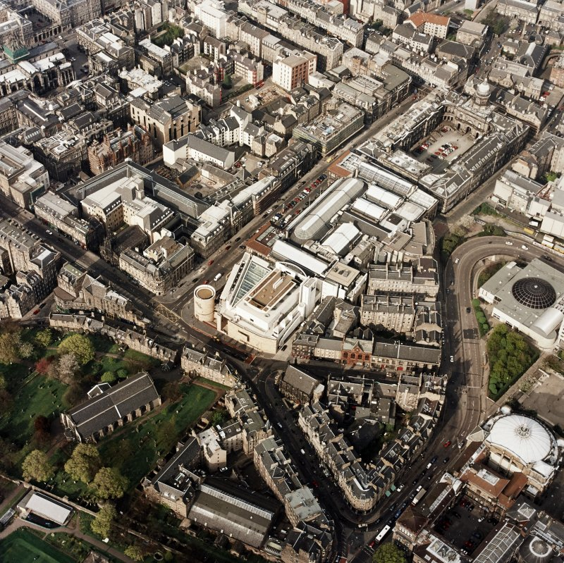 Oblique aerial view of Edinburgh centred on the Museum of Scotland, taken from the SSW.