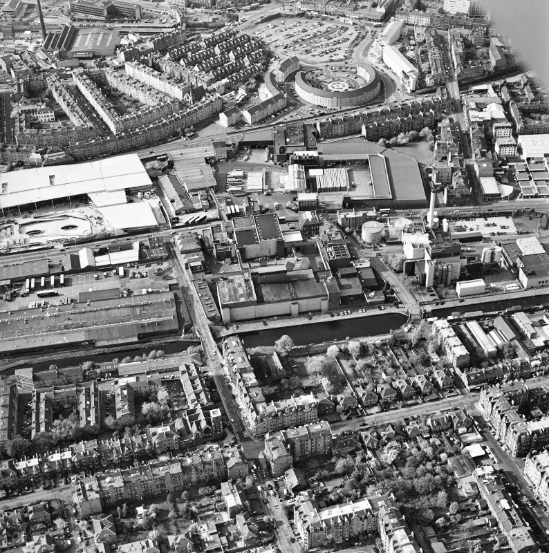 Oblique aerial view of Edinburgh centred on the Fountain Brewery, Fountainbridge, taken from the SSE.
