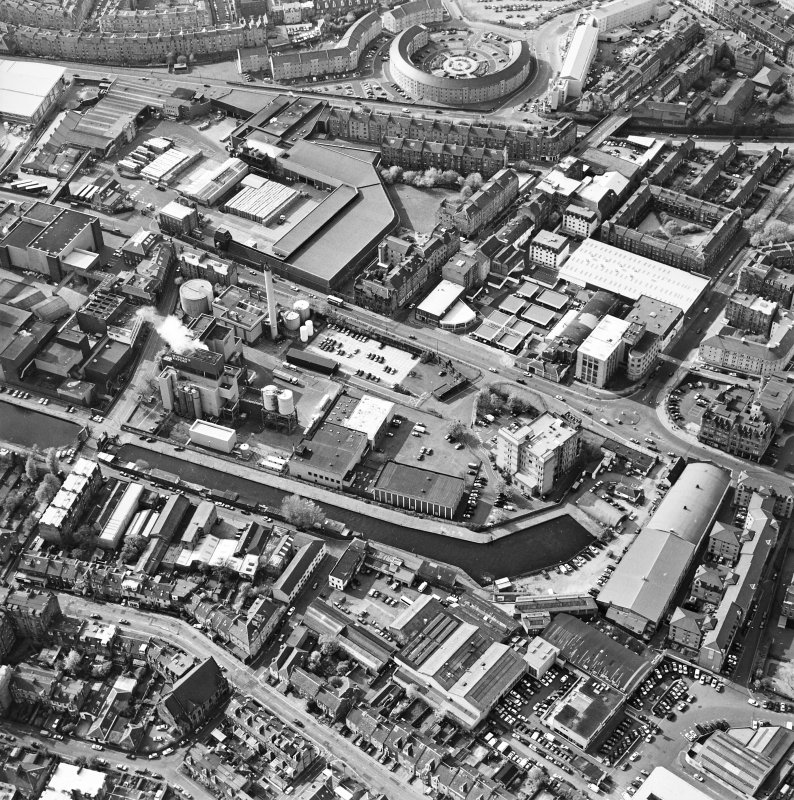 Oblique aerial view of Edinburgh centred on the Fountain Brewery, Fountainbridge, taken from the SE.