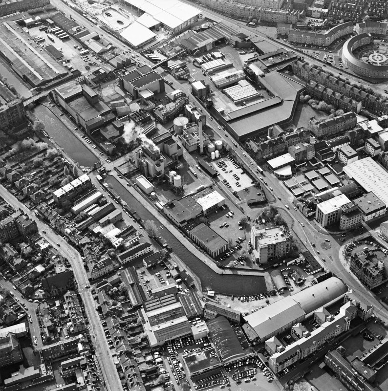 Oblique aerial view of Edinburgh centred on the Fountain Brewery, Fountainbridge, taken from the E.