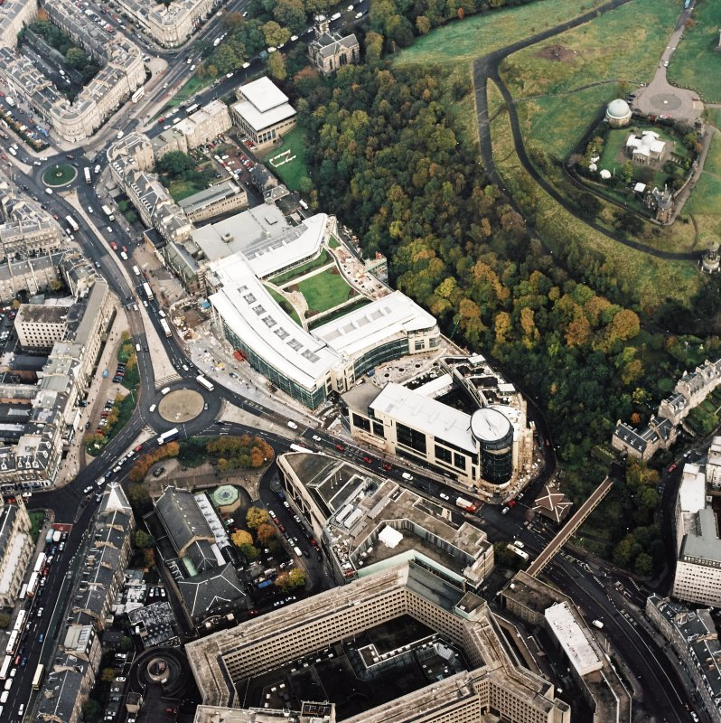 Oblique aerial view of Edinburgh centred on the Omni Plaza complex including the Calton Square development and St Mary's Cathedral, taken from the S.