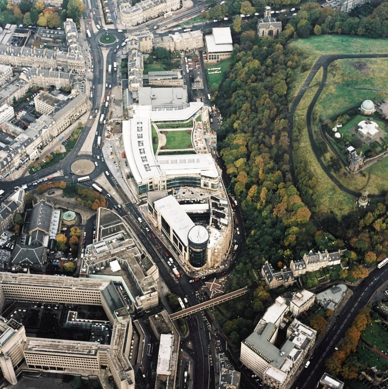 Oblique aerial view of Edinburgh centred on the Omni Plaza complex including the Calton Square development and St Mary's Cathedral, taken from the SE.
