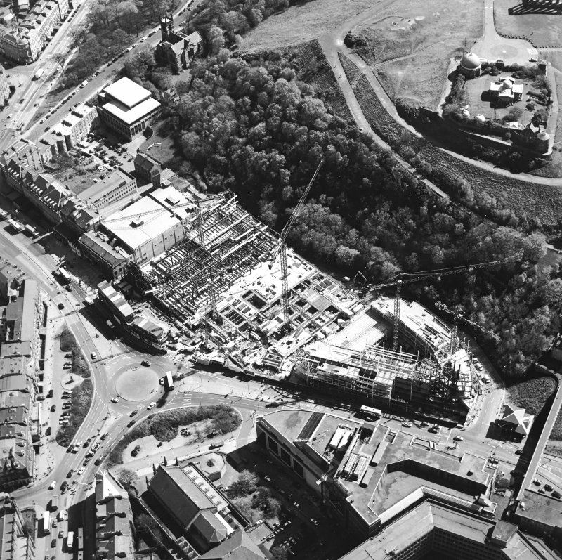 Oblique aerial view centred on the construction of the Omni Plaza with the observatory adjacent, taken from the W.