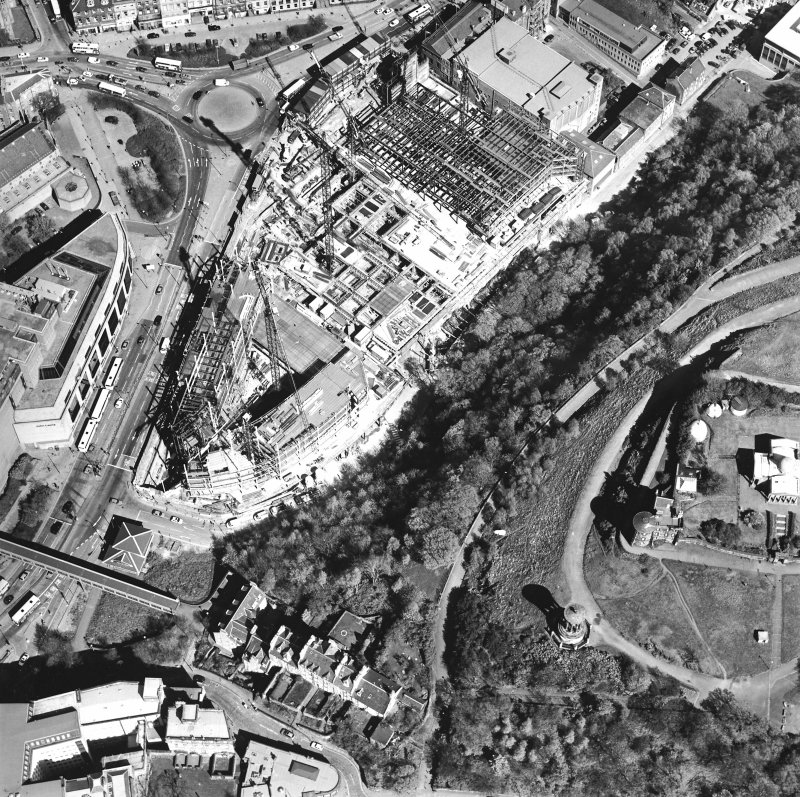 Oblique aerial view centred on the construction of the Omni Plaza with the observatory adjacent, taken from the S.