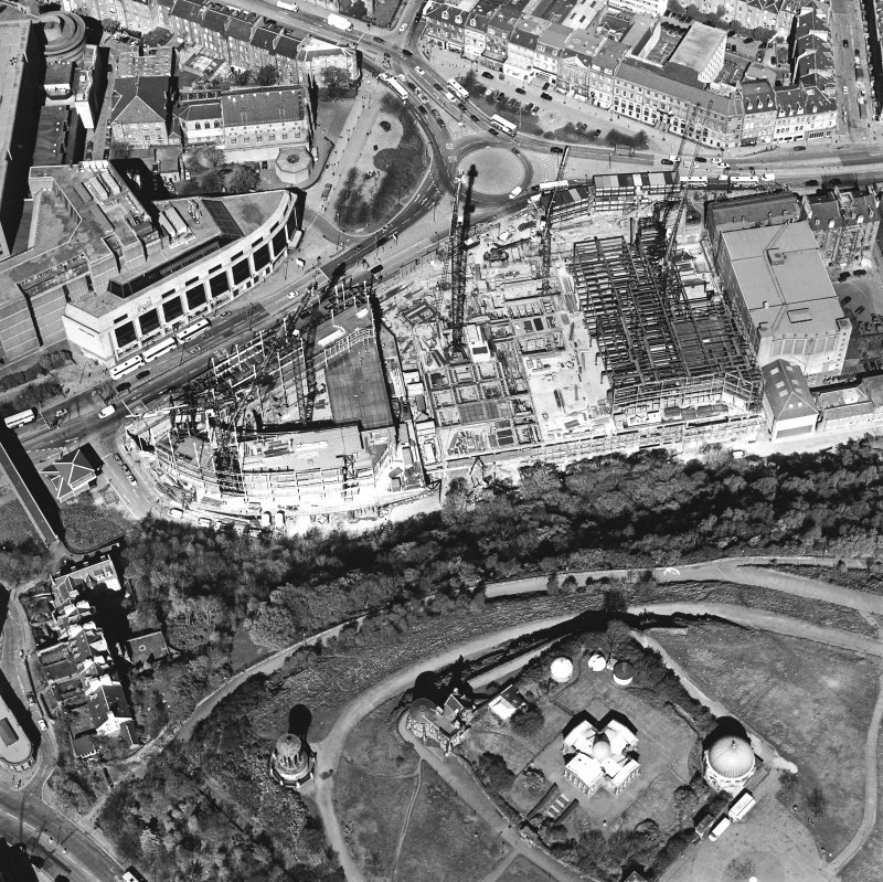 Oblique aerial view centred on the construction of the Omni Plaza with the observatory adjacent, taken from the SE.