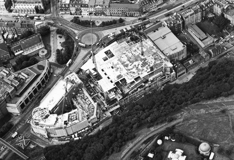 Oblique aerial view centred on the construction of the Omni Plaza, taken from the SE.