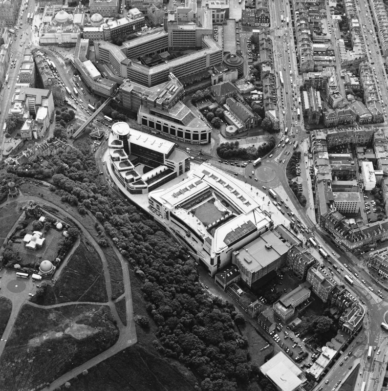 General oblique aerial view centred on the Omni Plaza with Calton Hill adjacent, taken from the NE.