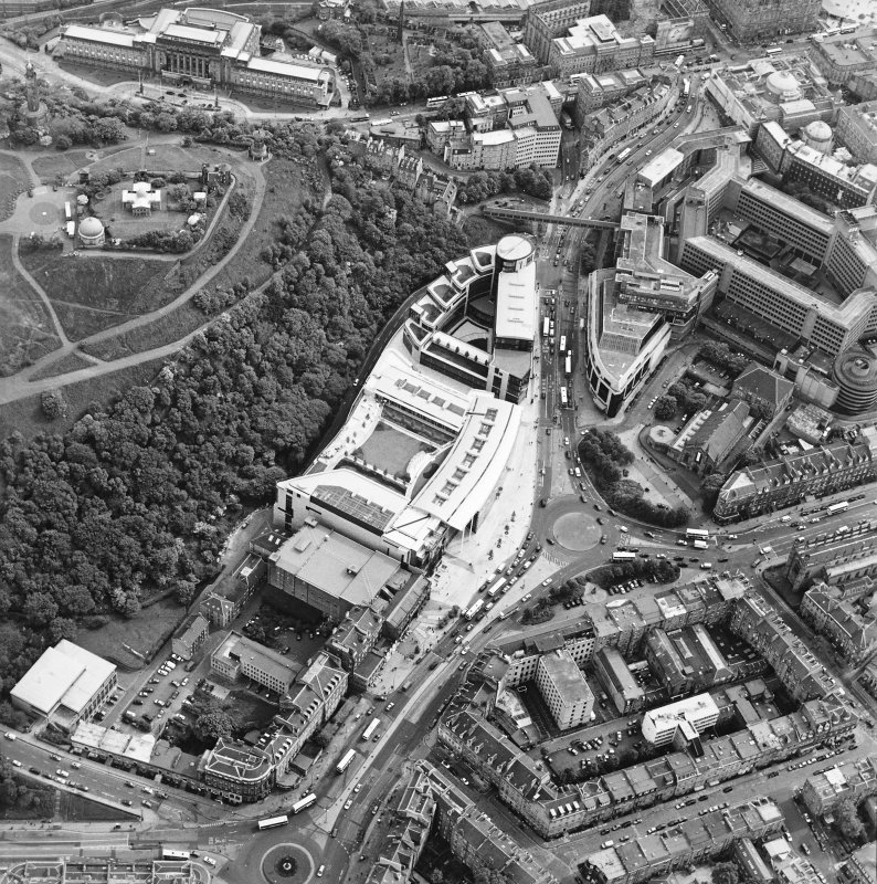 General oblique aerial view centred on the Omni Plaza with Calton Hill adjacent, taken from the NNE.