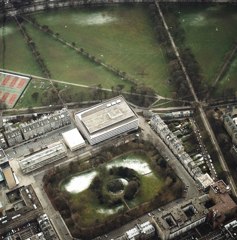 Oblique aerial view centred on the library with George Square, University buildings and Meadows adjacent, taken from the N.