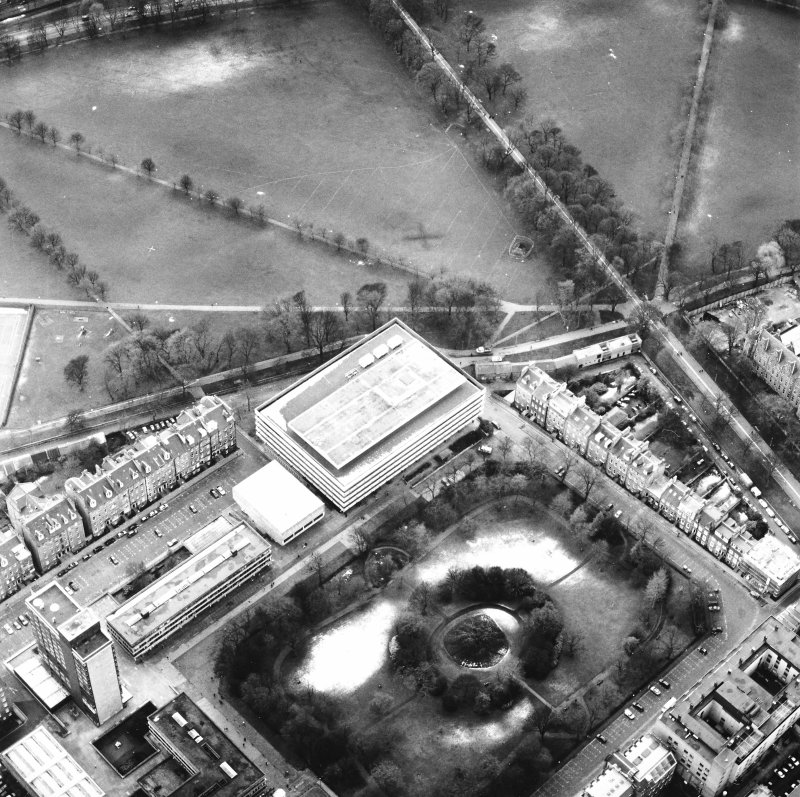 Oblique aerial view centred on the library with George Square, University buildings and Meadows adjacent, taken from the NE.