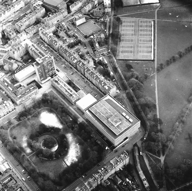 Oblique aerial view centred on the library with George Square and University buildings adjacent, taken from the NW.