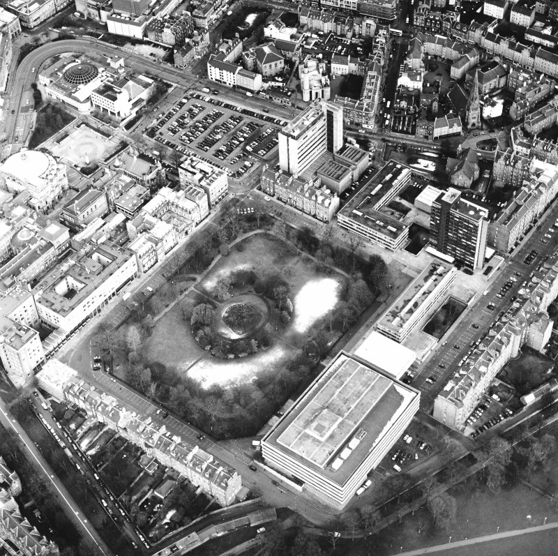 Oblique aerial view centred on the library with George Square and University buildings adjacent, taken from the SW.