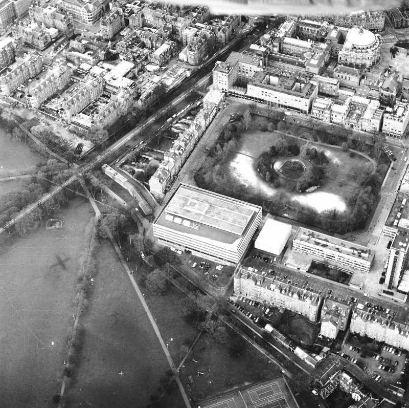 Oblique aerial view centred on the library with George Square and University buildings adjacent, taken from the SE.