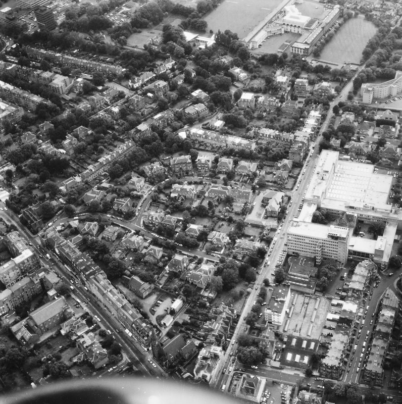 Oblique aerial view of Edinburgh centred on Merchiston.