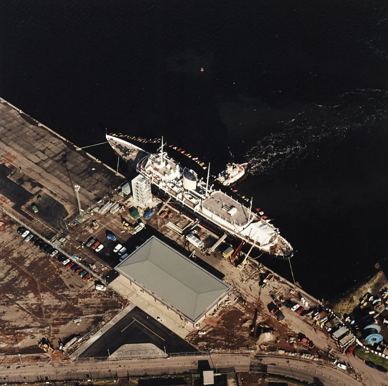 Oblique aerial view centred on HMRY Britannia and the temporary visitor centre, taken from the S.