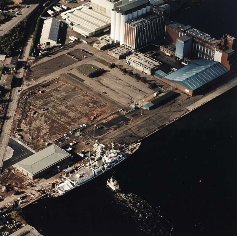 Oblique aerial view centred on HMRY Britannia and the temporary visitor centre, taken from the ENE.