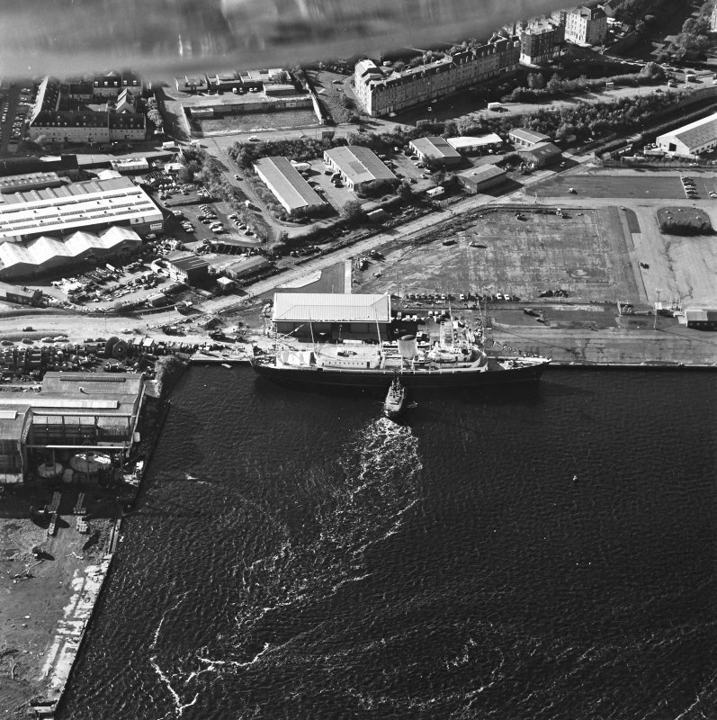 Oblique aerial view centred on HMRY Britannia and the temporary visitor centre, taken from the NE.