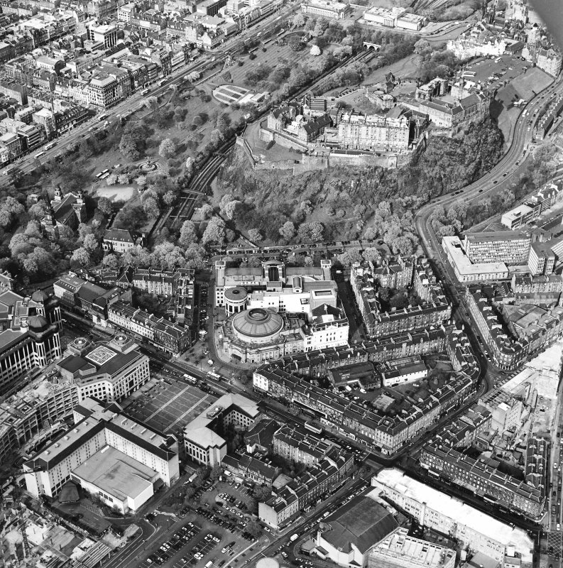 Oblique aerial view of Edinburgh centred on the Usher Hall with Edinburgh Castle behind, taken from the SW.