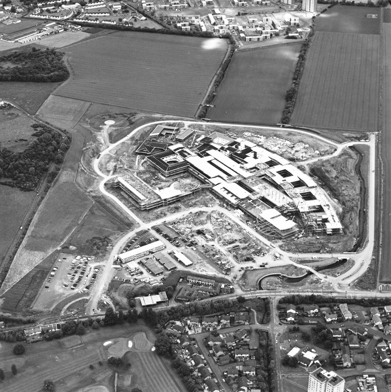 Oblique aerial view centred on the Royal Infirmary of Edinburgh at Little France under construction, taken from the SW.