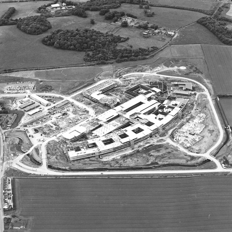 Oblique aerial view centred on the Royal Infirmary of Edinburgh at Little France under construction, taken from the SE.
