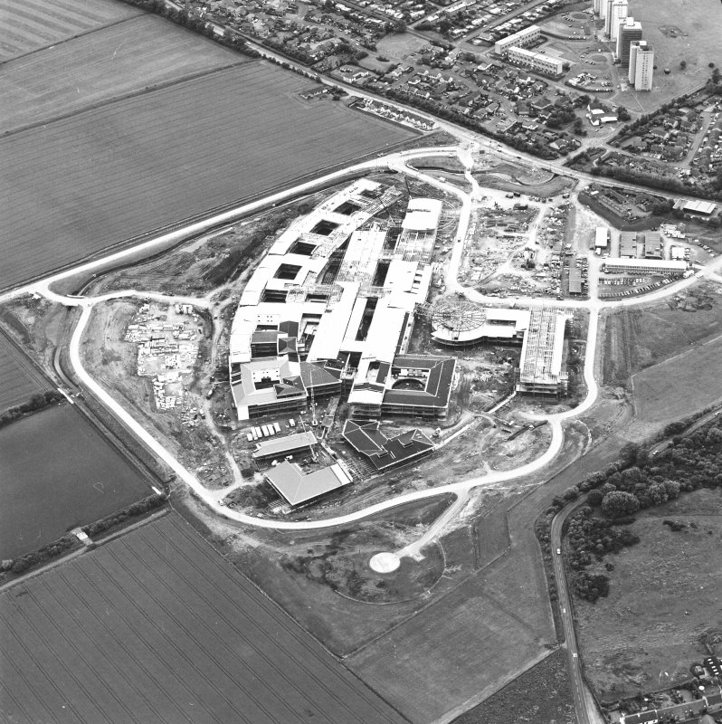 Oblique aerial view centred on the Royal Infirmary of Edinburgh at Little France under construction, taken from the NE.