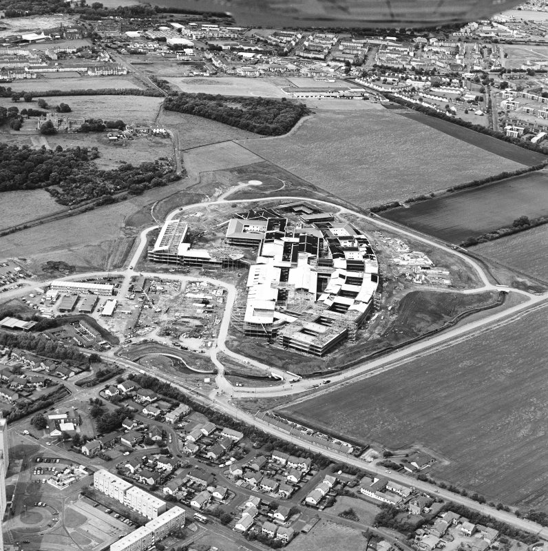 Oblique aerial view centred on the hospital under construction, taken from the S.