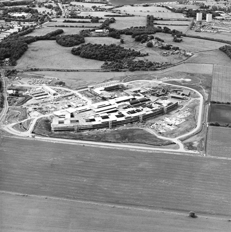 Oblique aerial view centred on the hospital under construction, taken from the SE.