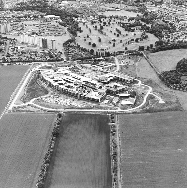 Oblique aerial view centred on the hospital under construction, taken from the NE.