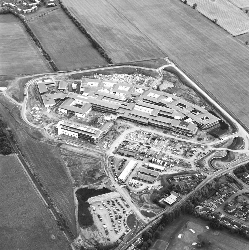 Oblique aerial view centred on the hospital under construction, taken from the W.
