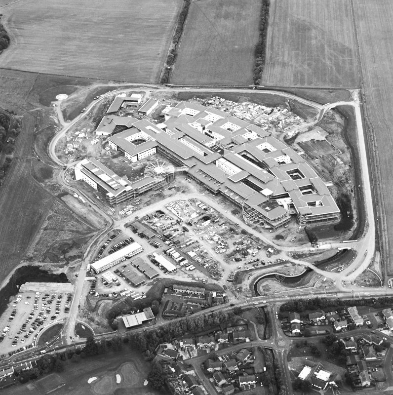 Oblique aerial view centred on the hospital under construction, taken from the SW.