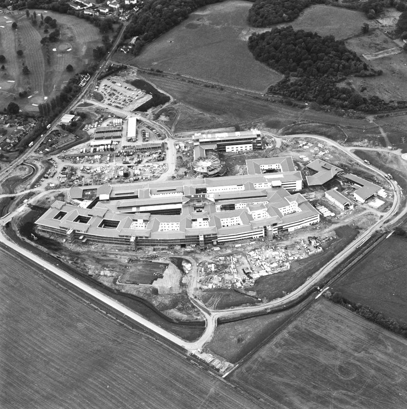 Oblique aerial view centred on the hospital under construction, taken from the E.