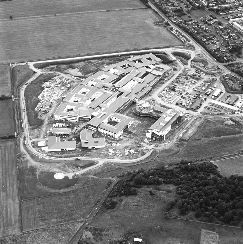 Oblique aerial view centred on the hospital under construction, taken from the NW.