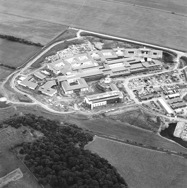 Oblique aerial view centred on the hospital under construction, taken from the WNW.
