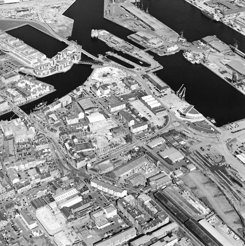 Oblique aerial view centred on the road bridge with the docks adjacent, taken from the ESE.