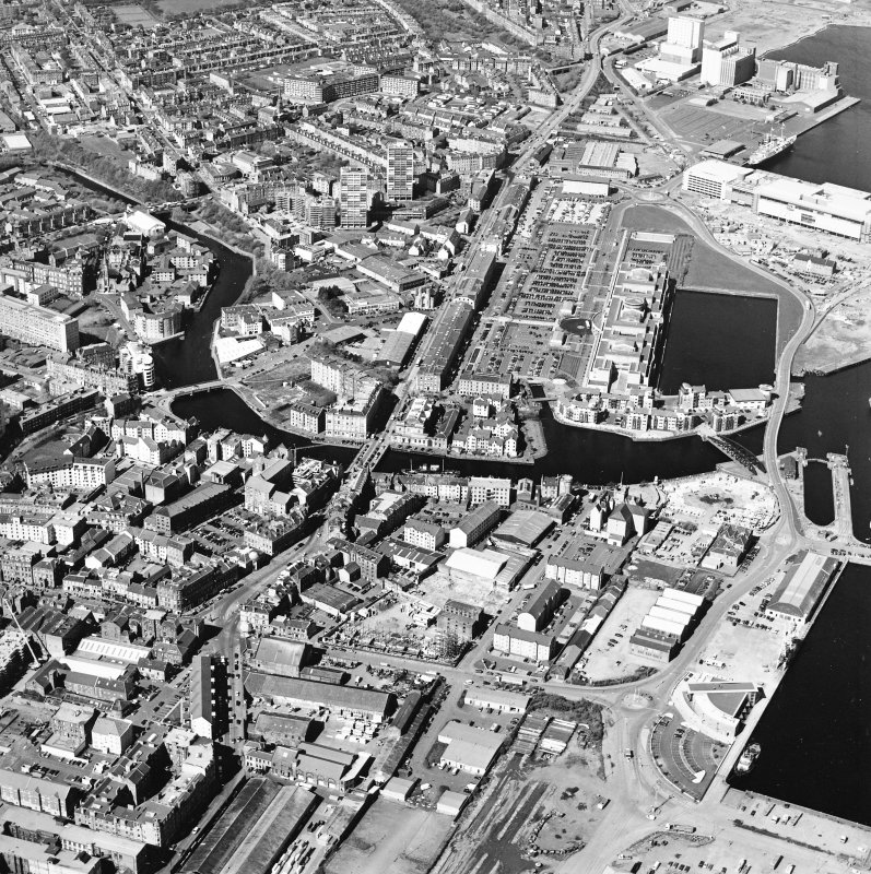 Oblique aerial view centred on the road bridge with the docks adjacent, taken from the E.