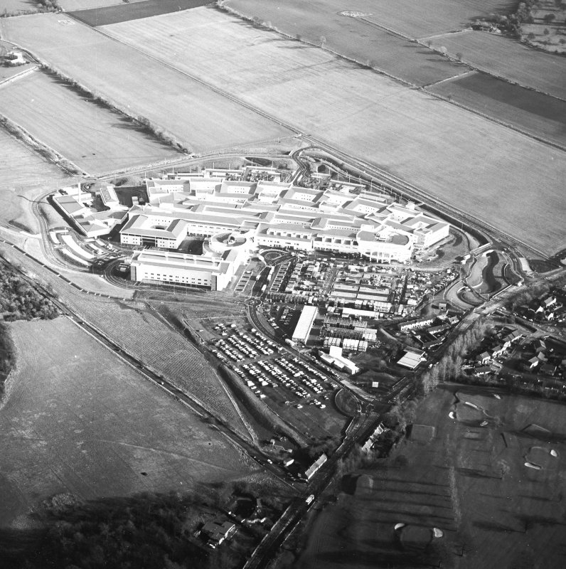 Oblique aerial view centred on the hospital, taken from the W.