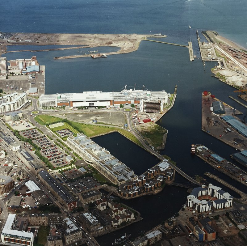 Oblique aerial view of Leith centred on the Ocean Terminal with Victoria Quay adjacent, taken from the SE.