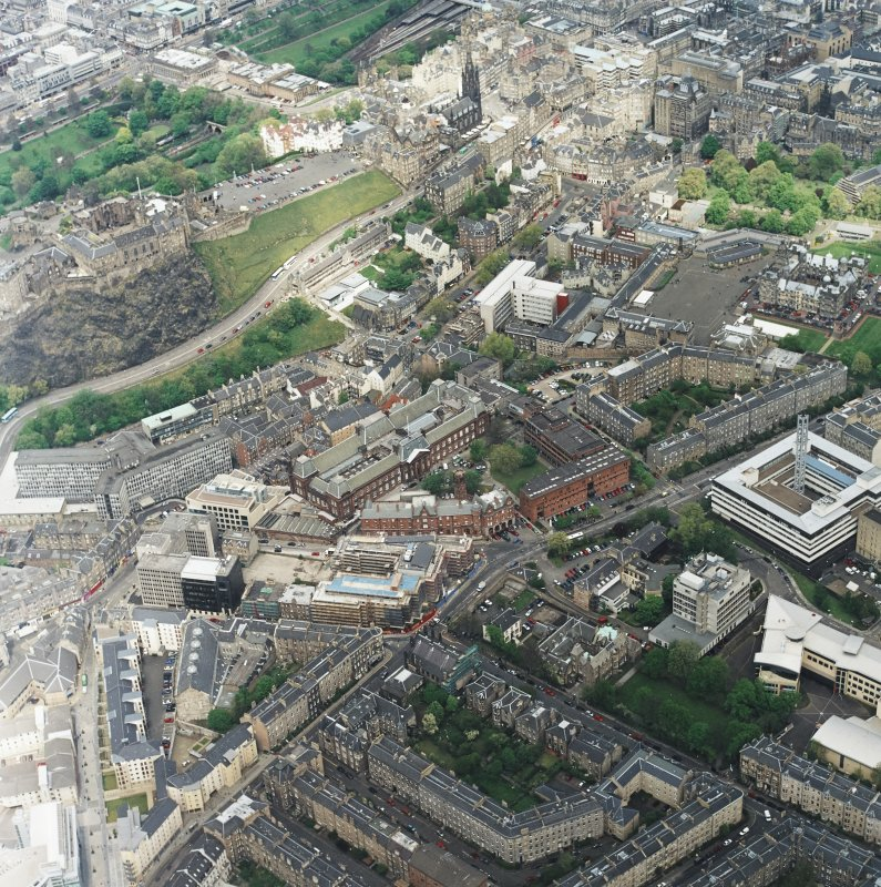 Oblique aerial view centred on the college with the chapel, hospital and school adjacent, taken from the SSW.