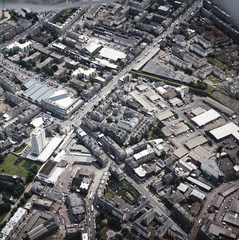 Oblique aerial view of Leith centred on the foot of Leith Walk and Great Junction Street, taken from the N.