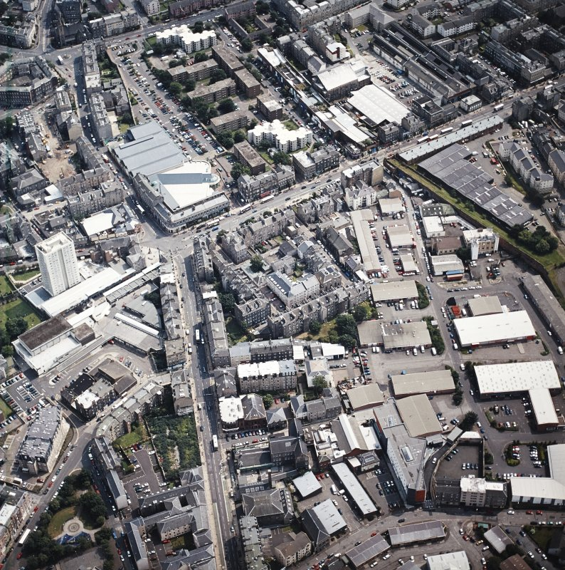 Oblique aerial view of Leith centred on the foot of Leith Walk and Great Junction Street, taken from the NW.