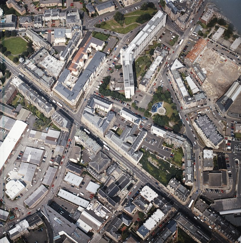 Oblique aerial view of Leith centred on Great Junction Street and Crabbies Winery, taken from the S.