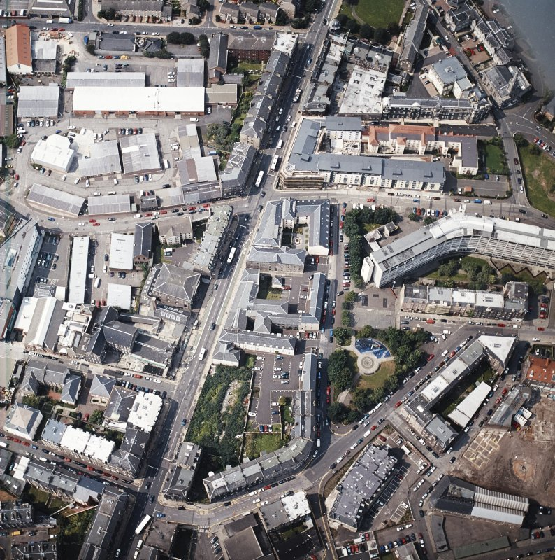 Oblique aerial view of Leith centred on Great Junction Street and Crabbies Winery, taken from the SE.