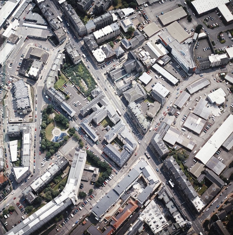 Oblique aerial view of Leith centred on Great Junction Street and Crabbies Winery, taken from the N.