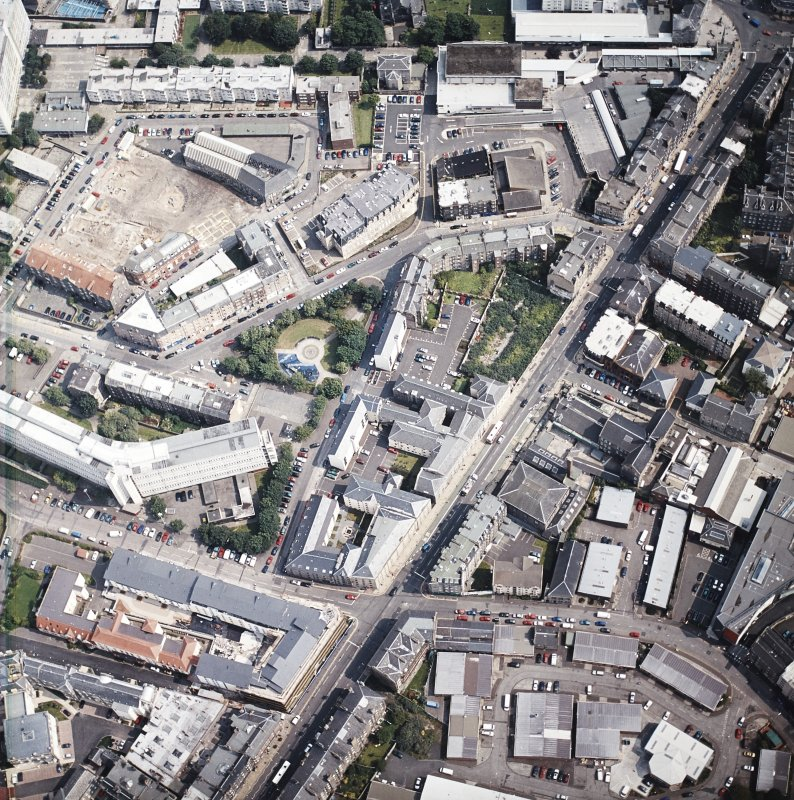 Oblique aerial view of Leith centred on Great Junction Street and Crabbies Winery, taken from the WNW.