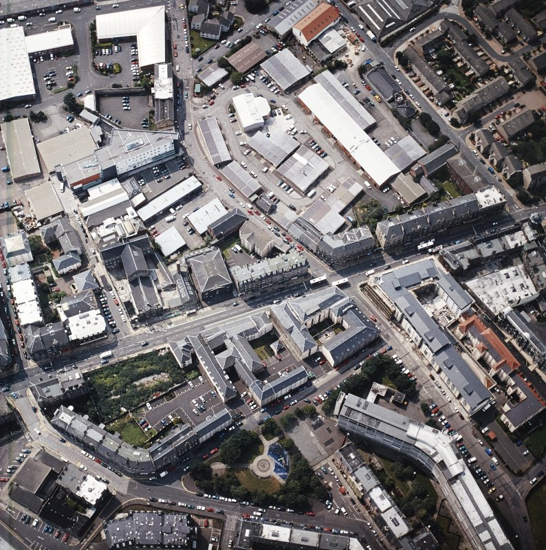 Oblique aerial view of Leith centred on Great Junction Street and Crabbies Winery, taken from the ENE.