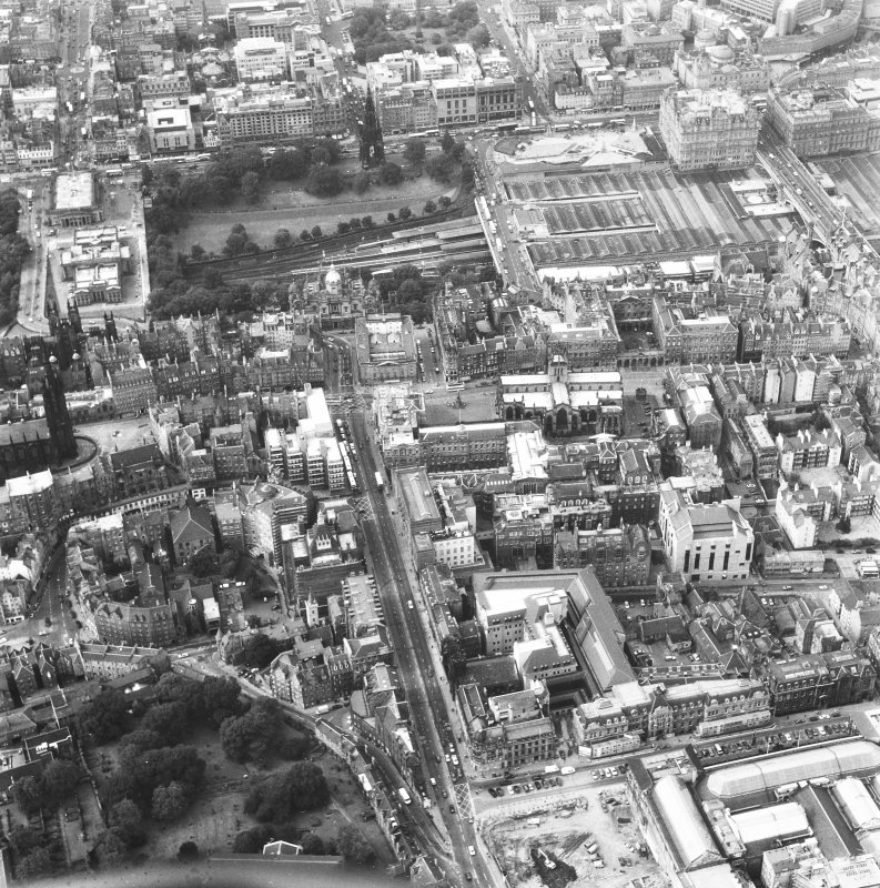 Aerial view of centre of Edinburgh including Princes Street at top of photograph, North Bridge to right, Royal Museum of Scotland and Candlemaker Row at bottom and Tolbooth Church and The Mound to left