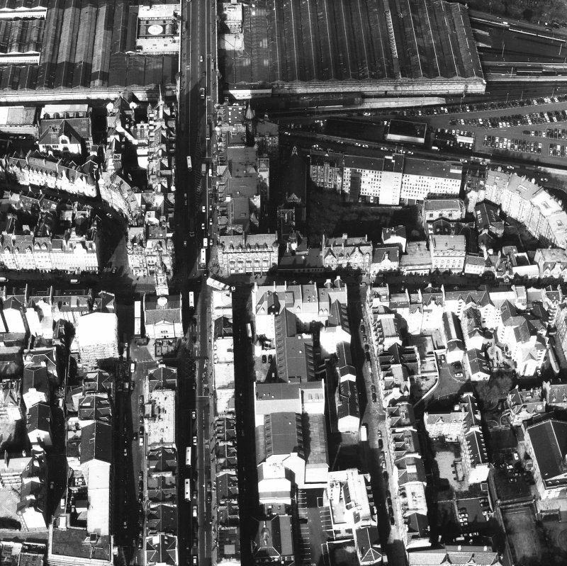 Aerial view of centre of Edinburgh including High Street running left to right across centre of photograph and North and South Bridges running top to bottom
