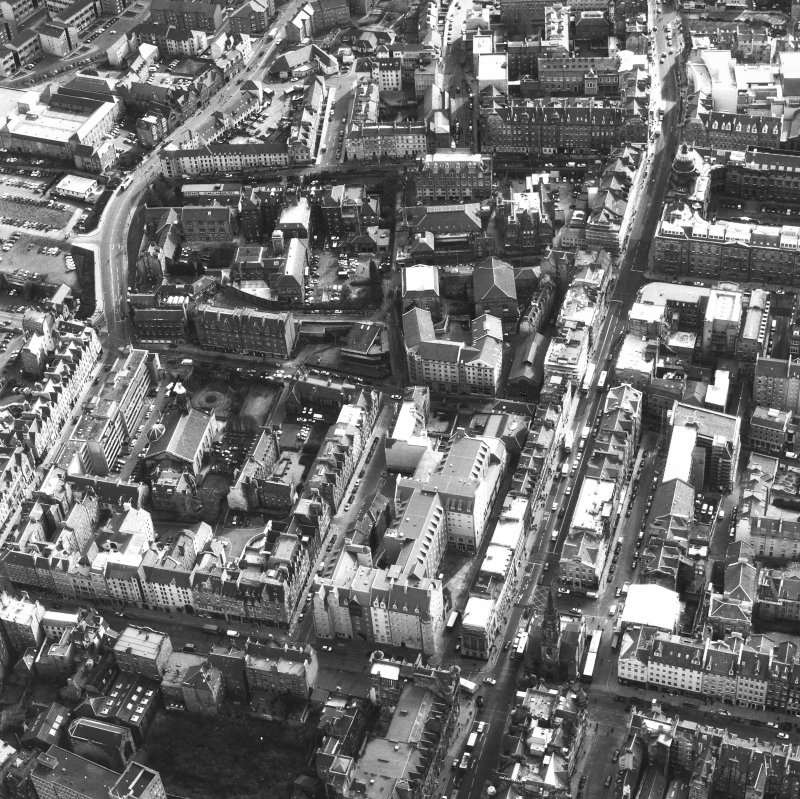 Aerial view showing North and South Bridges running top to bottom of photograph, with High Street at bottom, St Mary's Street and Pleasance to left and Old College to right