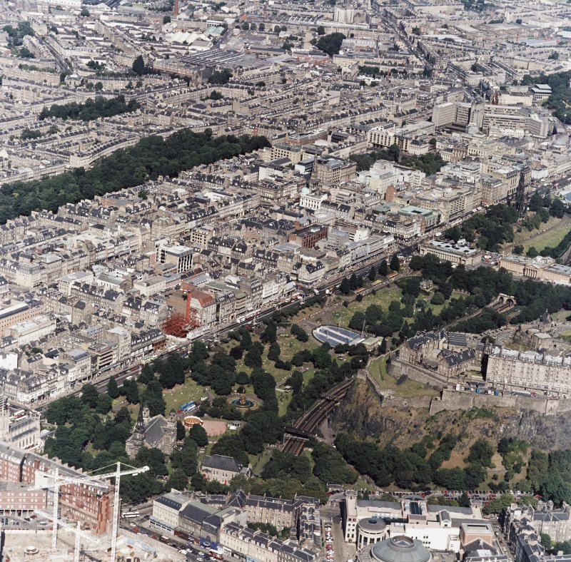 Oblique aerial view, taken from the SSW, showing the New Town in the centre of the photograph, and centred on Princes Street and Princes Street Gardens.