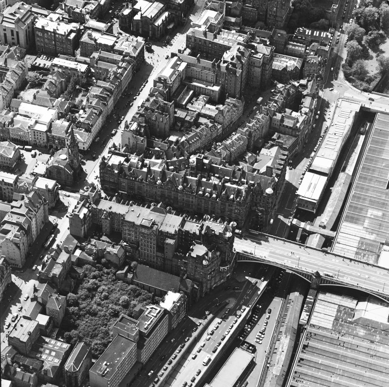 Oblique aerial view centred on the Scotsman buildings, taken from the E.